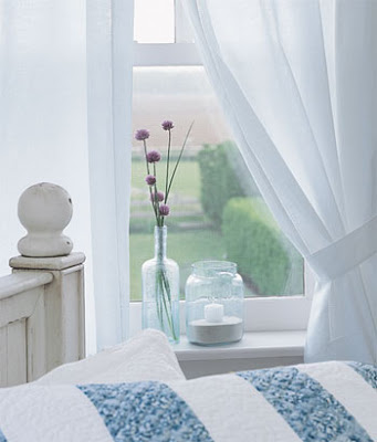 crisp white curtains in white bedroom