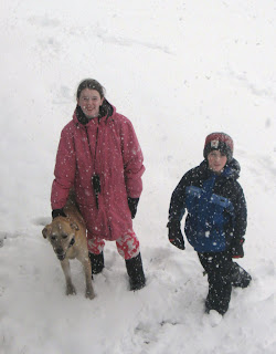Kids in snow with dog