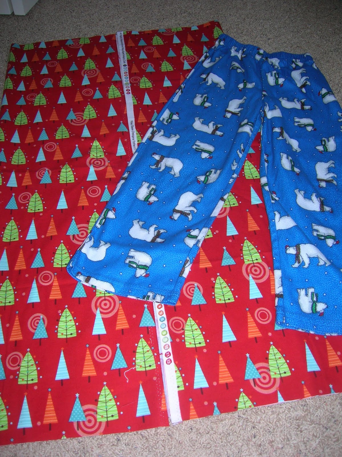 Fireside Plaid Fleece Matching Family Pajamas. These all-fleece pajamas are perfect for gathering in front of a warm fire on cold winter nights. Rich red top features deer applique that matches the pants; bottoms are made in a festive red plaid print great for the holidays and beyond.