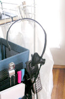 GTDmobile with telephone headset hanging by a shower curtain ring