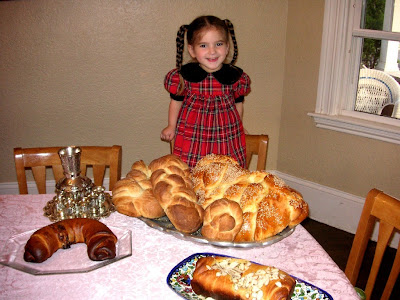 Gretta surveying lots of baked goods, Shabbat Shalom!