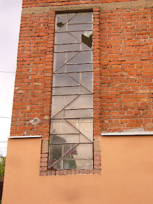 A Long Vertical Glass Framed Window In Yambol City Centre