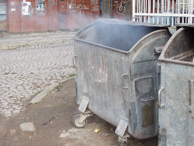 A Smoking Wheelie Bin In Yambol