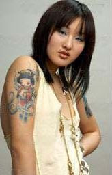 Asian woman with tattoos
