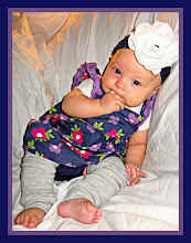 Scarlett models baby leggings and flower clip/headband.