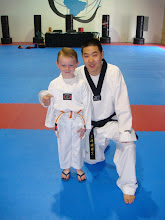 Ethan and his Taekwondo instructor Master Sohn at his belt testing