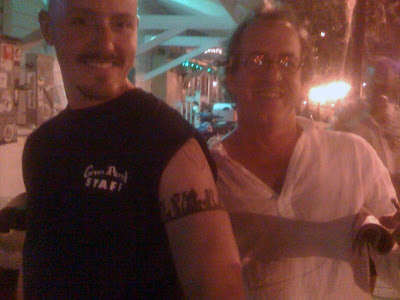 Doorman Justin proudly sports his Tradesman's tattoo for sculptor and