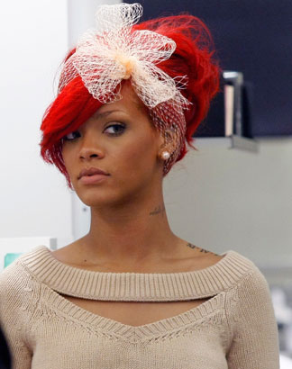 rihanna red hair color. hair done like two. With