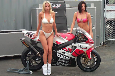 2 Sexy Girls on Bike Yamaha MotoGp. One of them wear white bikini, ...
