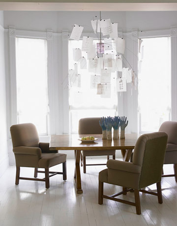 this contemporary dining room features the zettel z 5 chandelier by