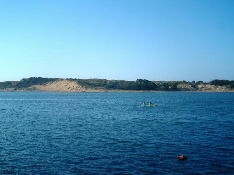 canoa en el Abra del Pas en Mogro