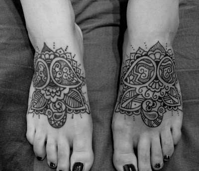 Comments: These feet were tattooed at different times.