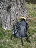 rucksack and poles by a tree