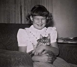 Robin Atkins and her first cat, Tippy; 1951