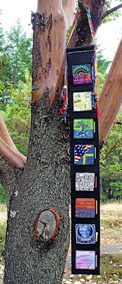 bead journal project, banner hanging from tree