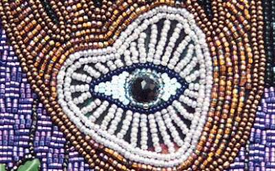 bead embroidery by Robin Atkins, detail of bag showing eye and heart