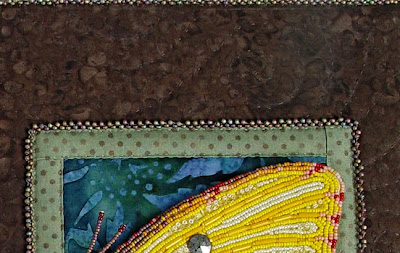 stitching bead embroidery to fabric, detail, by robin atkins
