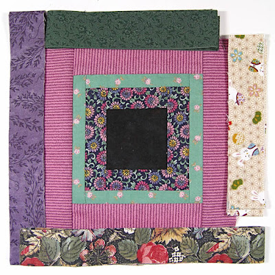 God's Eye quilt by Robin Atkins, auditioning fabrics 19