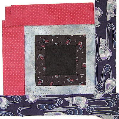 God's Eye quilt by Robin Atkins, auditioning fabrics, 2 choices