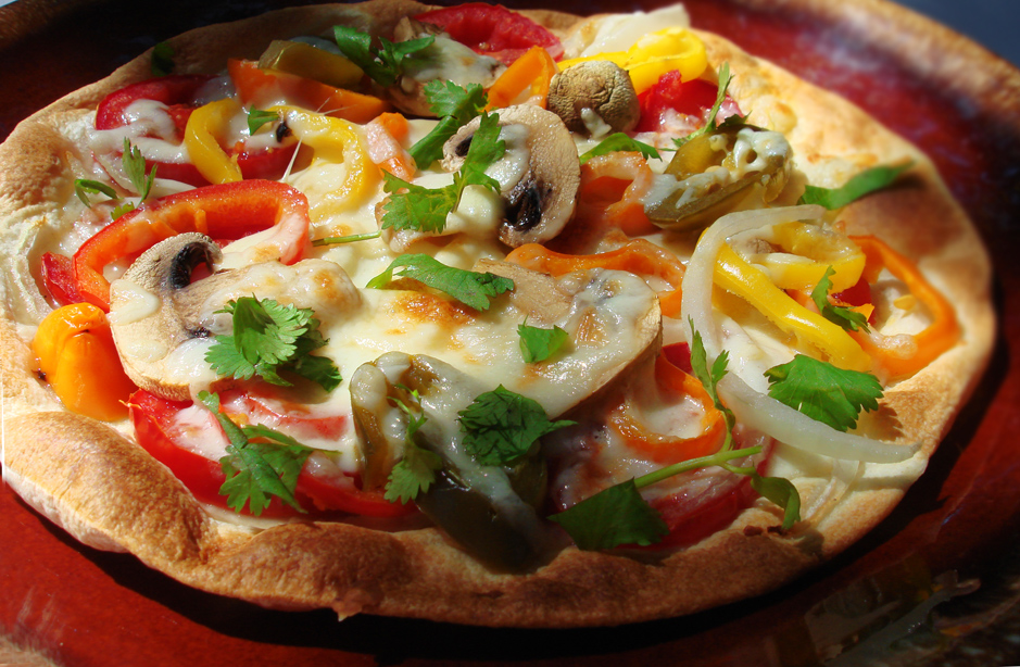 ... Tortilla Topped With Veggies and Cheese- And Baked- Tortilla Pizza