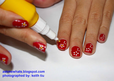 Using a yellow nail polish pen (or any bright color pen), create a BUD on