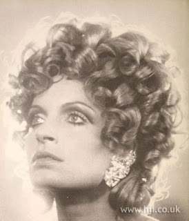 tousled type of hairstyle popularized by surfers in the 1960s and 1970s.