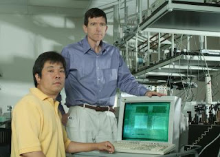 Caption: Haiyu Wang, Neal Woodbury (l-r) and colleagues at the Biodesign Institute at ASU have provided new insight into the basic mechanisms of photosynthesis, a biological process that supports all life on earth. The biodesign team has shown that it is protein motion that determines the dynamics of the initial electron transfer reactions of photosynthesis, rather than static interactions between cofactors. The Biodesign researches use an ultrafast laser facility to capture 'snapshots' of the electron transfer at femtosecond rates, or a fifteen millionth of a second. Credit: Barb Backes, Biodesign Institute at Arizona State University, Usage Restrictions: None.