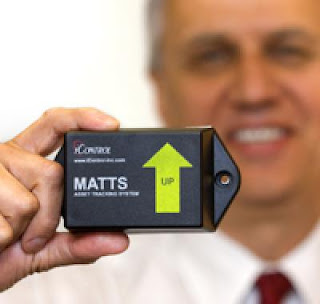 Caption: S&T's Cargo Security program manager, Bob Knetl, with the MATTS container tag. Credit: DHS, Usage Restrictions: None.