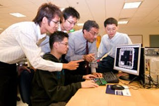 Krishna Palem (second from right) is working with Yeo Kiat Seng (right) and students at the Centre for Integrated Circuits and Systems at Nanyang Technological University in Singapore to develop the first production prototypes of a new type of power-stingy computer chip called PCMOS. NANYANG TECHNOLOGICAL UNIVERISTY