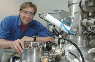 Caption: Matthias Bode, Center for Nanoscale Materials, is shown with his enhanced spin polarized scanning tunneling microscope (SP-STM). His enhanced technique allows scientists to observe the magnetism of single atoms. Use of this method could lead to better magnetic storage devices for computers and other electronics. Credit: DOE/Argonne National Laboratory. Usage Restrictions: None.