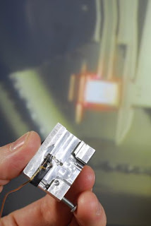 An AFM holder adapted so that the FIRAT probe can be used on existing AFM systems