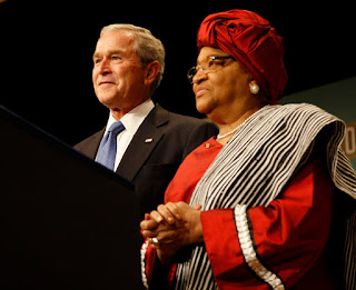 President George W. Bush stands with Liberian President Ellen Johnson Sirleaf