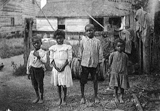 Four black children in yard
