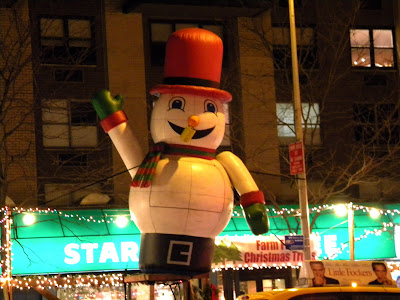 Snowman at Christmas tree lot