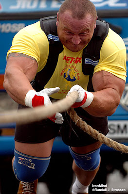 "Mariusz Pudzianowski Hometown: Bia Rawska (in Central Poland ) Age: 27 Height: 6' 3/4"" (184cm) Weight:  313 lbs  (142 kg) Chest:   53  ½"" Biceps:  21 1/3"" Profession: Professional Strongman"