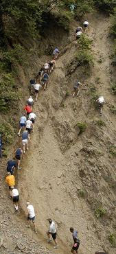 2006: The men's field of Tuesday's Mount Marathon race heads up the rocks at the base of the mountain.