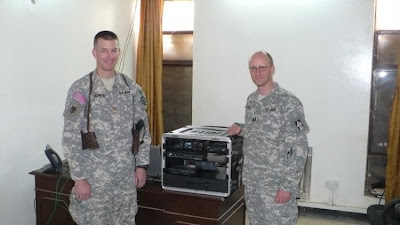 Army Major Scott Hedberg, AD7MI (left), of Leavenworth, Kansas, hands over the BARS station duties to Army Captain Jeffrey Hammer, N9NIC, of Speedway, Indiana, in April 2008. [Photo courtesy of Army MARS]