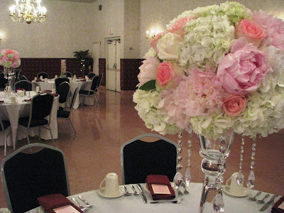This one is a tall centerpiece with hydrangea peonies roses and crystals