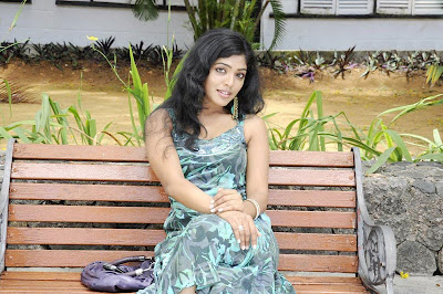 Rima kallingal Sitting on a Bench