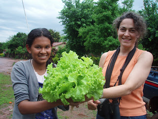 Image of two women holding lettuce