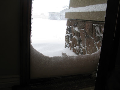 Snow drifted up against the front door.