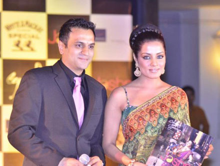Celina Jaitley in green saari at Launching Jashns  Calendar navel show