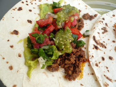 ... is an older picture of a taco with pico de gallo and tomatillo salsa