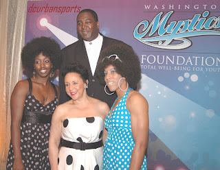 Coach Rollins poses with Mystics teammates Tamara James and Alana Beard, and owner Sheila Johnson at Mystics Foundation gala. (see http://dculs.com/mfgala.html).