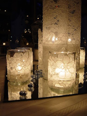 I like the look of candles and votives on mirrors the lace adds a nice
