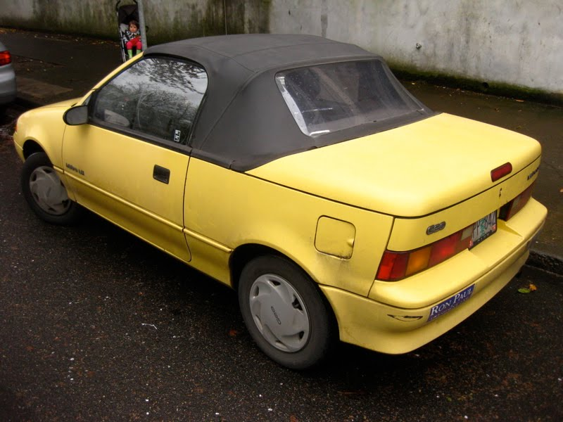 OLD PARKED CARS.: 1990 Geo Metro LSi Convertible.