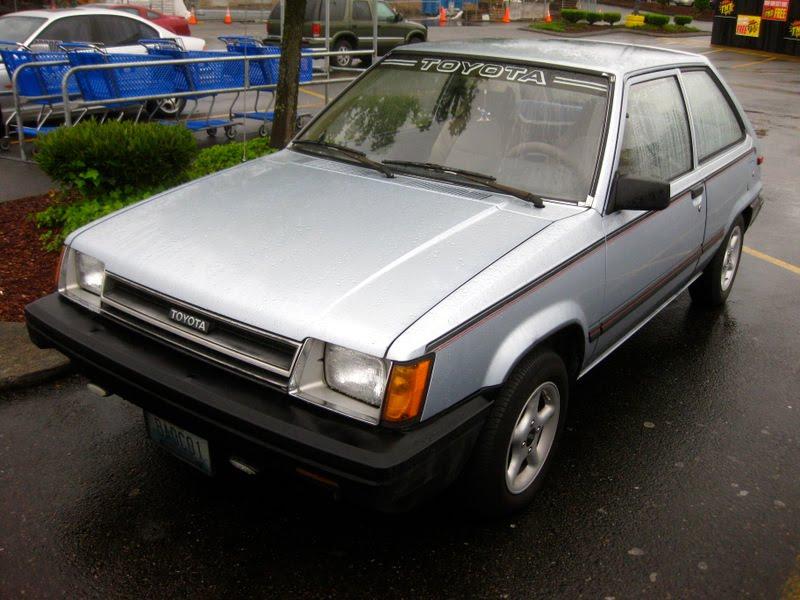 OLD PARKED CARS.: 1983 Toyota Tercel Hatchback.