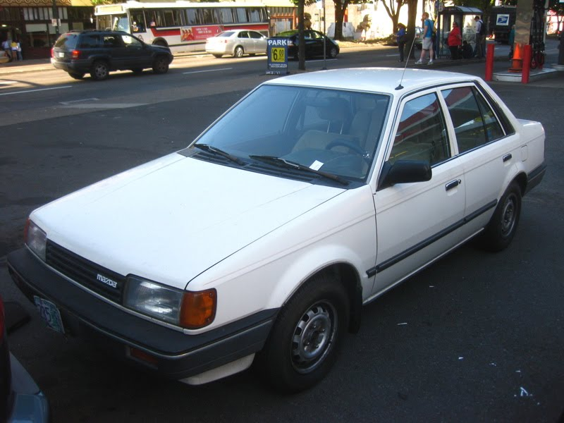 OLD PARKED CARS.: 1986 Mazda 323 DX 1.6i Sedan.