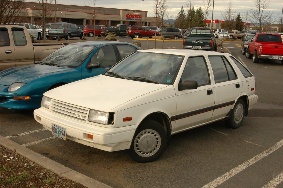OLD PARKED CARS.: 1989 Hyundai Excel GL 5-Door Hatchback.