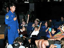 Astronaut Shane Kimbrough speaks with a group of Aviation Camp kids at the Fernbank Science Center